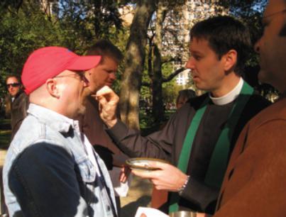 Fr. David Fleenor distributes Holy Communion in Madison Square Park, October, 2008.