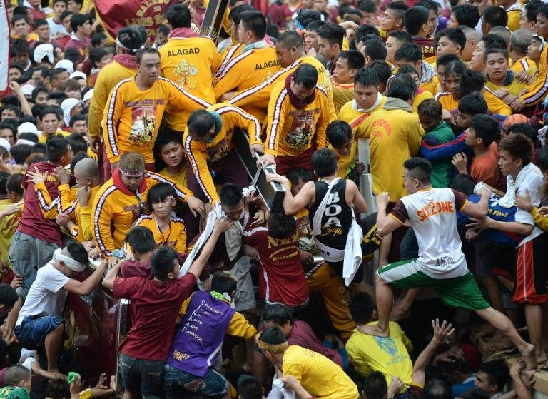 Religious icon of the Black Nazarene during the annual religious procession in Manila