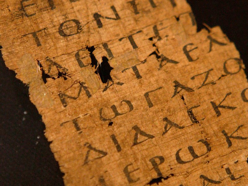 A fragment from a copy of the Gospel of John, circa 200 CE, is displayed at Sotheby's auctioneers in London. Researchers now claim to have found a gospel text that is over 100 years older. (SUZANNE PLUNKETT/Reuters/Corbis)