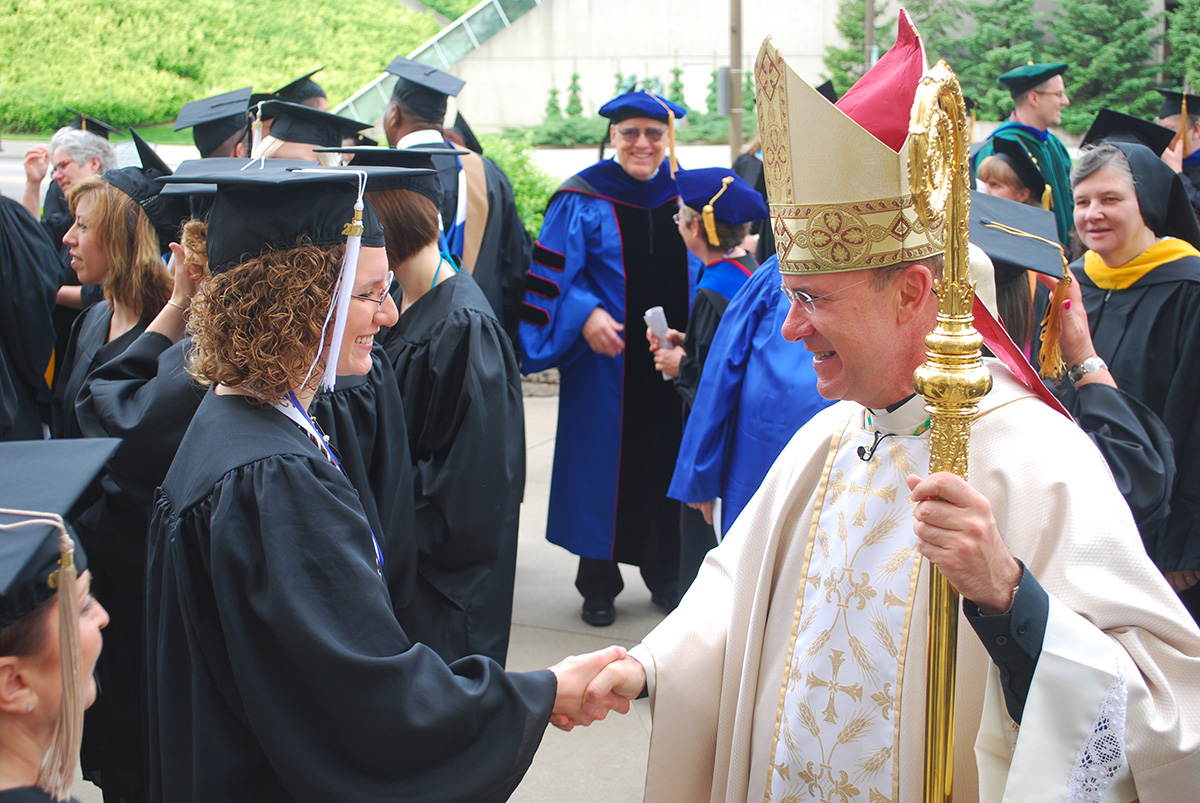 Bishop Kevin C. Rhoades (Fort Wayne-South-Bend) congratulates graduates of the University of Saint Francis after a baccalaureate Mass on May 1, 2010. Photo: Today's Catholic News.