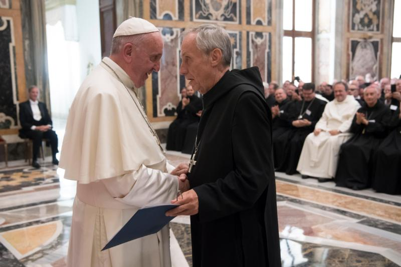 Pope Francis greets Abbot Primate Notker Wolf, superior of the Benedictine order, during a meeting with the heads of Benedictine monasteries from around the world at the Vatican Sept. 8. The Benedictines are meeting in Rome Sept. 3-16 to elect a new abbot primate. (CNS photo/L'Osservatore Romano, handout) See POPE-BENEDICTINES and VATICAN-LETTER-BENEDICTINES Sept. 8, 2016.