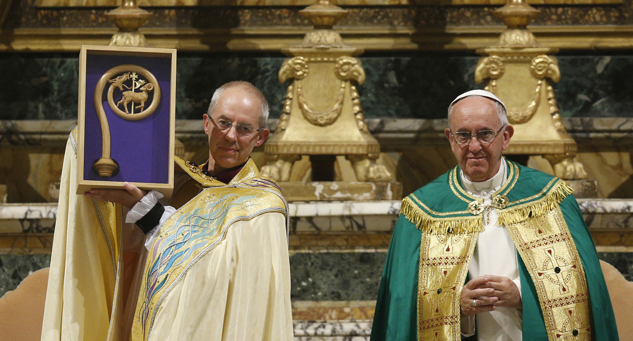 Anglican Archbishop Justin Welby of Canterbury, England, spiritual leader of the Anglican Communion, holds a replica of the staff of St. Gregory the Great given by Pope Francis at a vespers service at the Church of St. Gregory in Rome Oct. 5. (CNS photo/Paul Haring) See POPE-ANGLICAN-PRAYER Oct. 5, 2016.